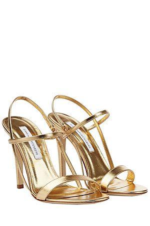 Crafted from metallic gold leather, these striking sandals are full of Diane von Furstenberg's statement, feminine attitude #Stylebop