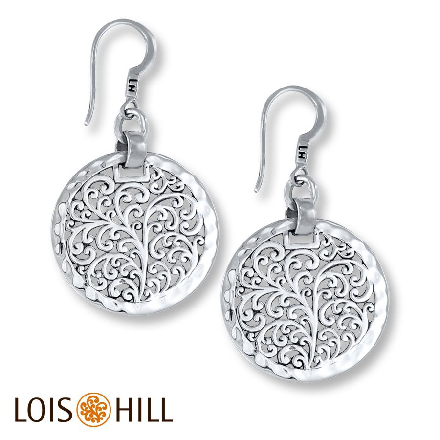 Carved scrolls flourish through circular discs of sterling silver in