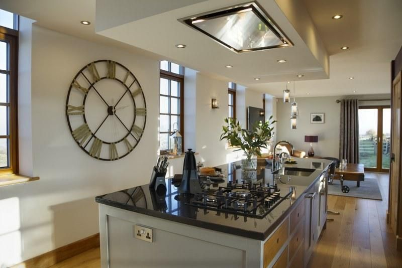 The gorgeous handmade kitchen is filled with light and boasts a room