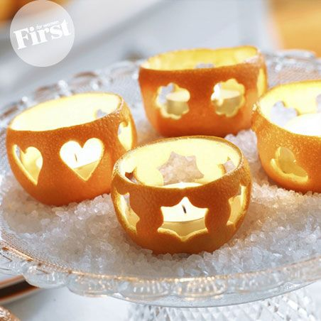 Citrus fruits make sweet candle cups. Could be very sweet for a fall theme!