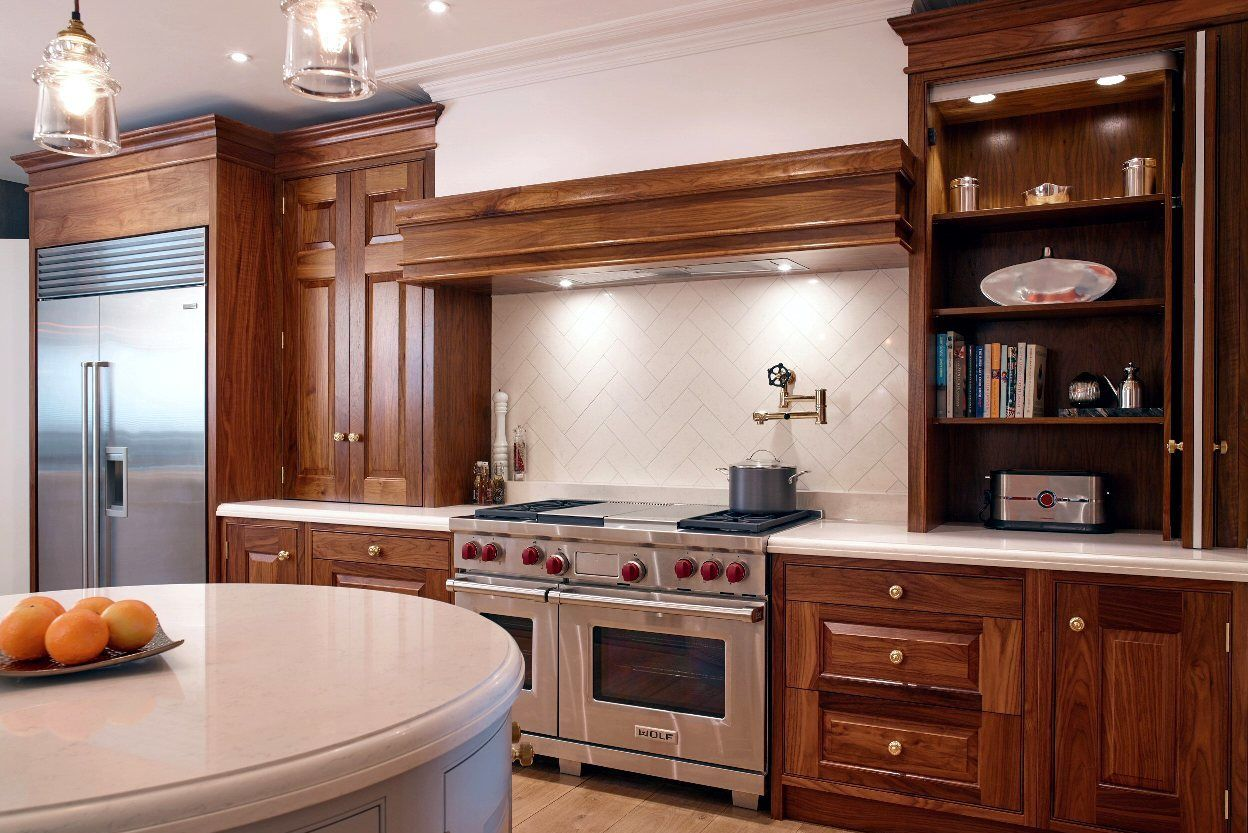This kitchen features retractable dresser cabinets, (which allow appliances and clutter to be concealed elegantly), a Wolf Range Cooker and a Sub Zero Fridge Freezer. Chamber Furniture, The Old Timber Yard, London Road, Halstead, Kent, TN14 7DZ United Kingdom. Tel 01959 532 553. www.chamberfurniture.co.uk