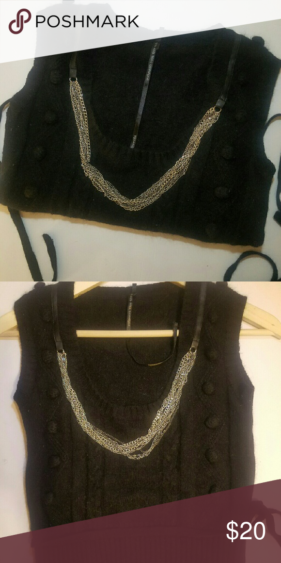 Rabbi hair sweater vest Fun and edgy vest with chain and button detail Ties at waist 50% rabbit 40% acrylic 10% nylon Sweaters