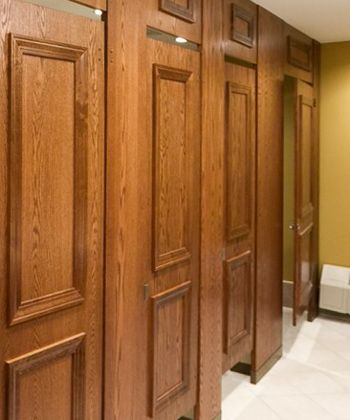 public bathroom doors. ironwood manufacturing wood veneer toilet partition and bathroom doors with molding. beautiful, upscale public