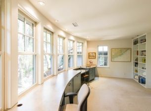 Huge windows frame the view in this charming cottage in the woods at 75 New Settlement Road on #Kiawah Island (available for sale as of 06.16.16), which won a Conservancy award for its environment-friendly landscaping #LuxuryRealEstate