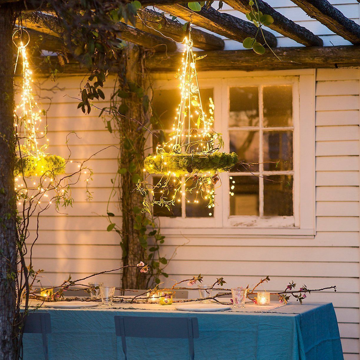 Use small starry string lights and wrap around metal chandelier