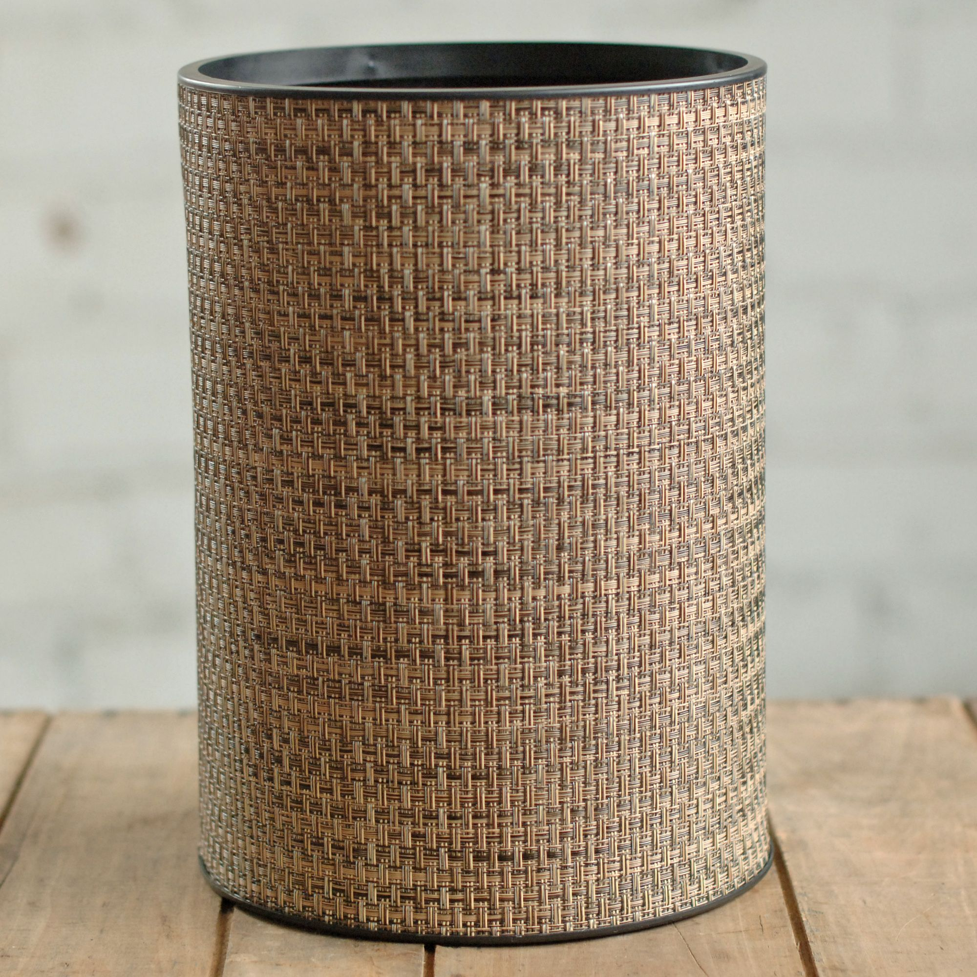 This contemporary standard wastebasket is composed of woven PVC/polyester fabric. Cleaning is easily accomplished with a damp cloth.