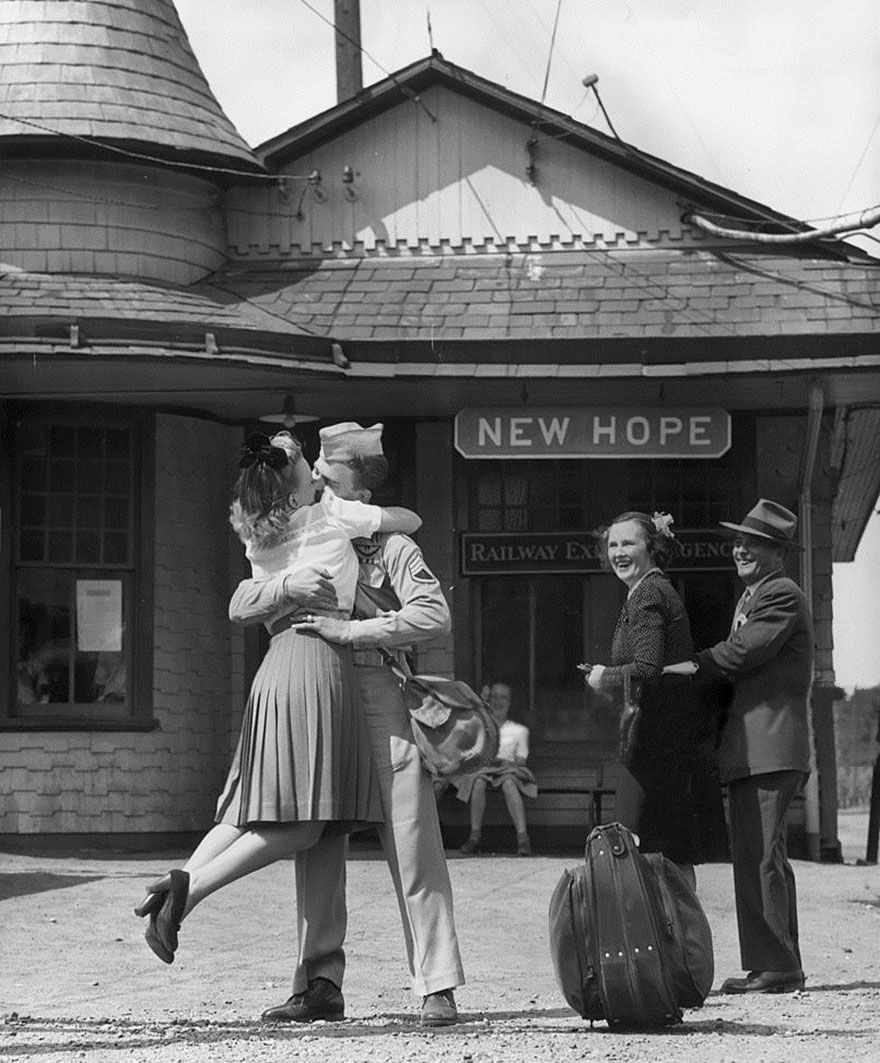 A Young Woman Lifts Her Feet While Embracing And Kissing A Uniformed Us Soldier At The Train Station, Connecticut, 1945