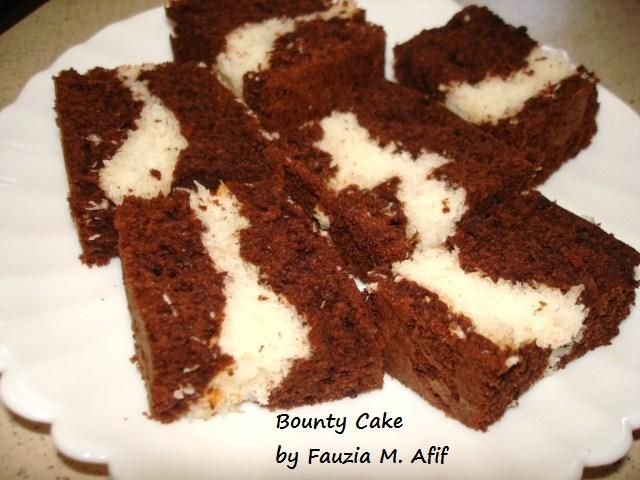 This delicious chocolate cake has a suprise coconut filling in its centre.