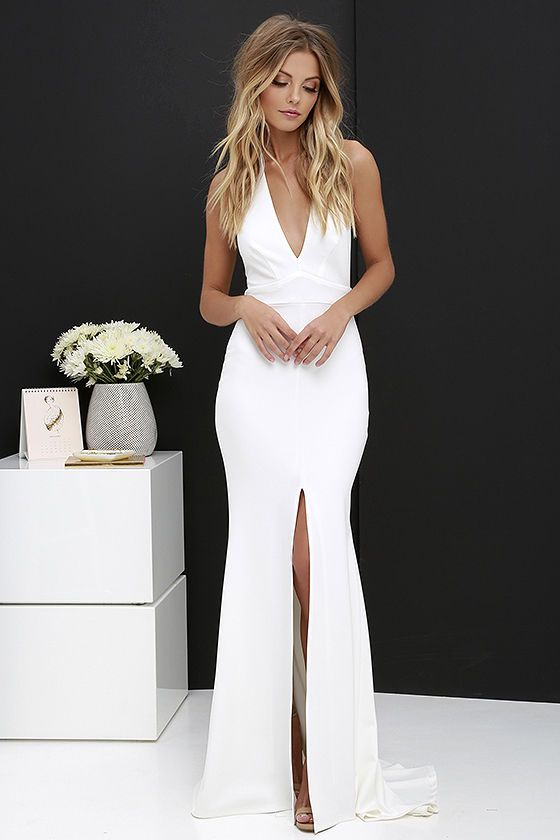 fd5e1ba333f You may forget that the clock is about to strike midnight when you re  having your Cinderella moment in the Time Out of Mind Ivory Halter Maxi  Dress!