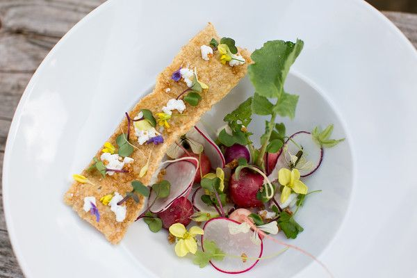 Salad of biodynamic easter egg radishes and blooms, Soledad goat cheese, crispy red quinoa