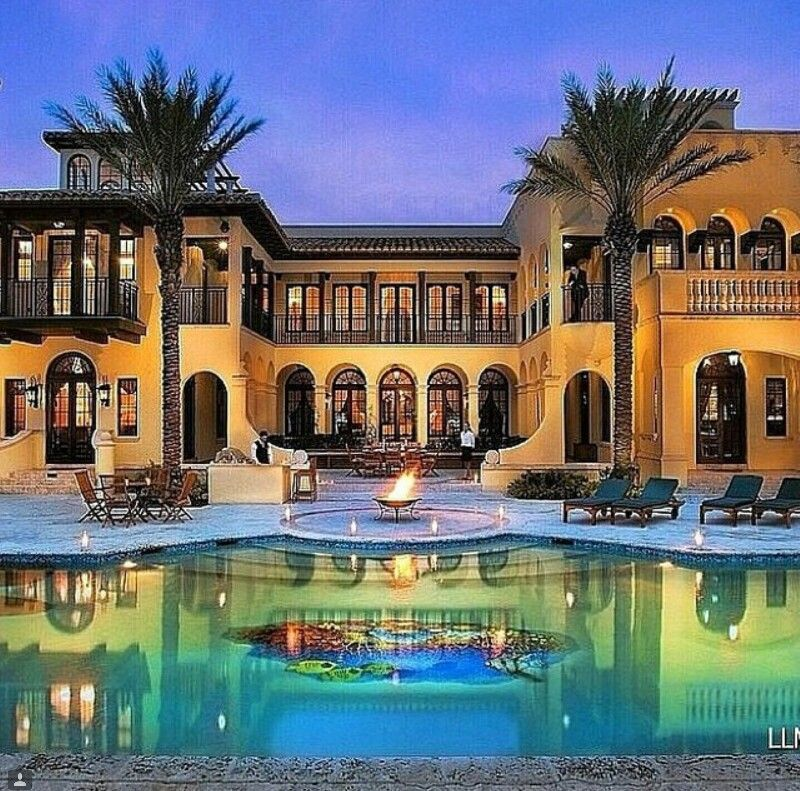 luxury mediterranean inspired mansion exterior design with swimming pool