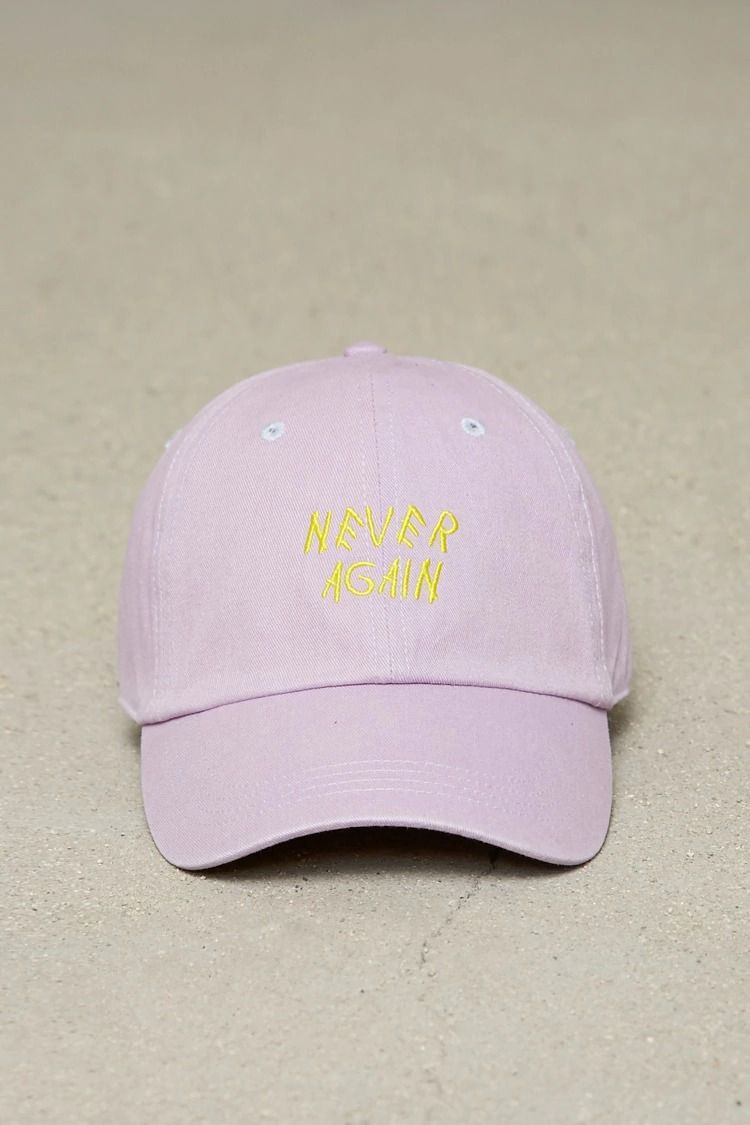 A cotton woven dad cap featuring an embroidered