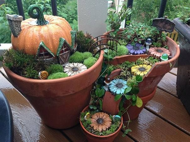 Oh Fake Pumpkin From Michaels Paint Stones To Look Like Flowers Moss From Dollar Store Fairy Garden Diy Fairy Garden Designs Fairy Garden