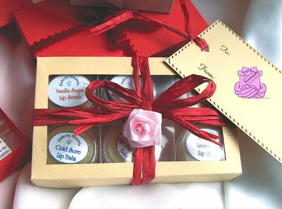 """6 Pack Gift Set of Lip Balms & Sugar Lip Scrubs contains 4 Lip Balms 2 Sugar Scrubs by and comes in your choice of a """"see thru"""" top, or a solid red gift box hand ties with red ribbon. View my listing at https://www.etsy.com/listing/170745272/  for a listing of their all natural ingredients and gift box details. $15.95"""