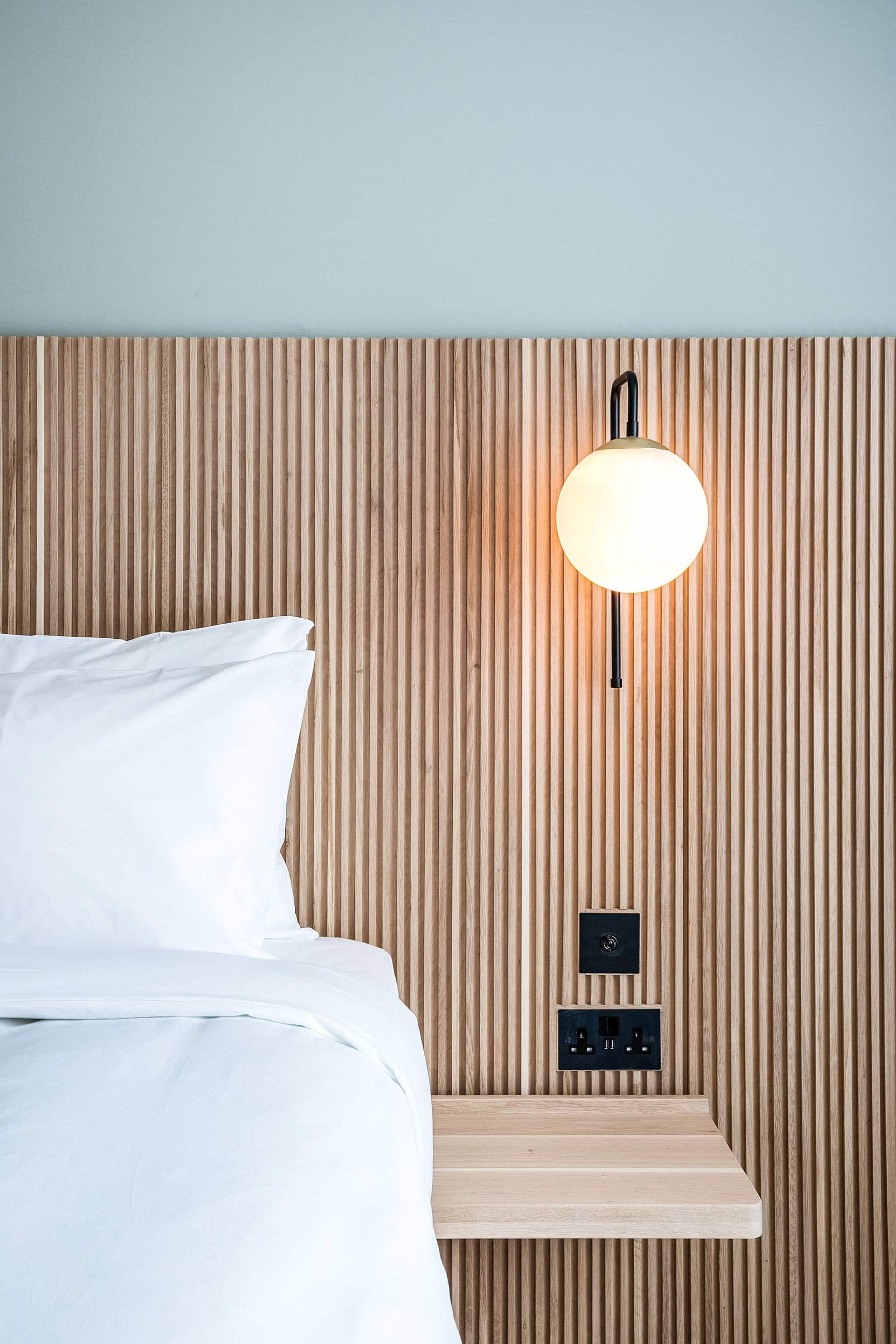 "The ""Headboard Sconce"" Might Be Our Favorite Hotel-Inspired Small Bedroom Hack - Emily Henderson"