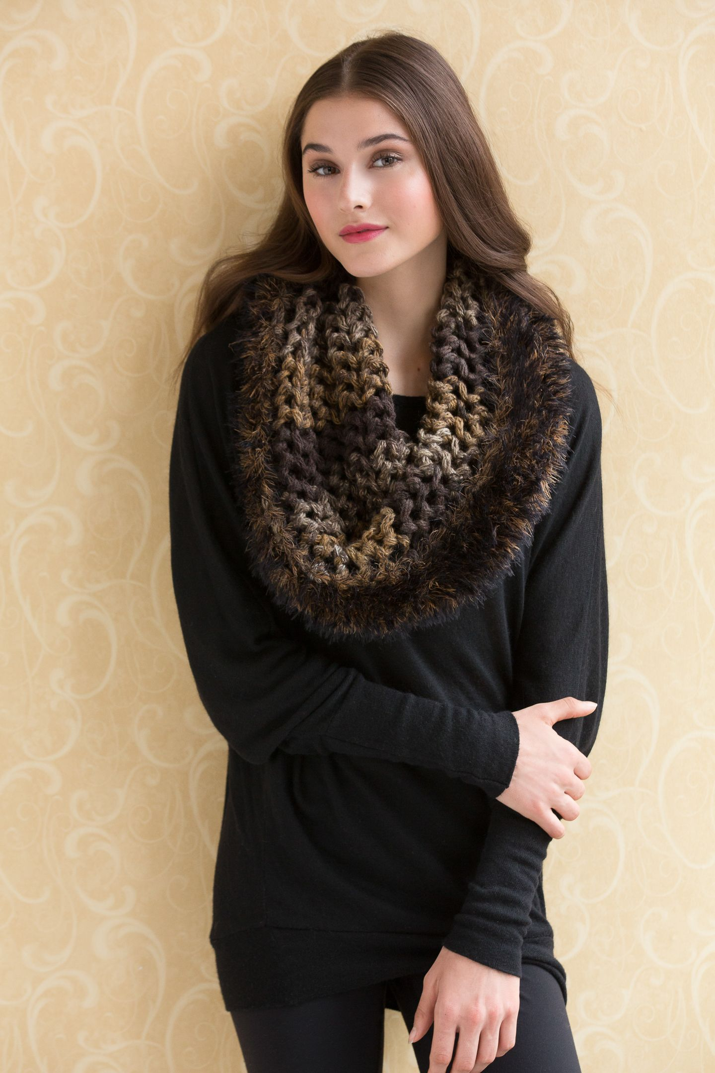 The chainette yarn of HUDSON is knit in a mesh stitch pattern, while ...