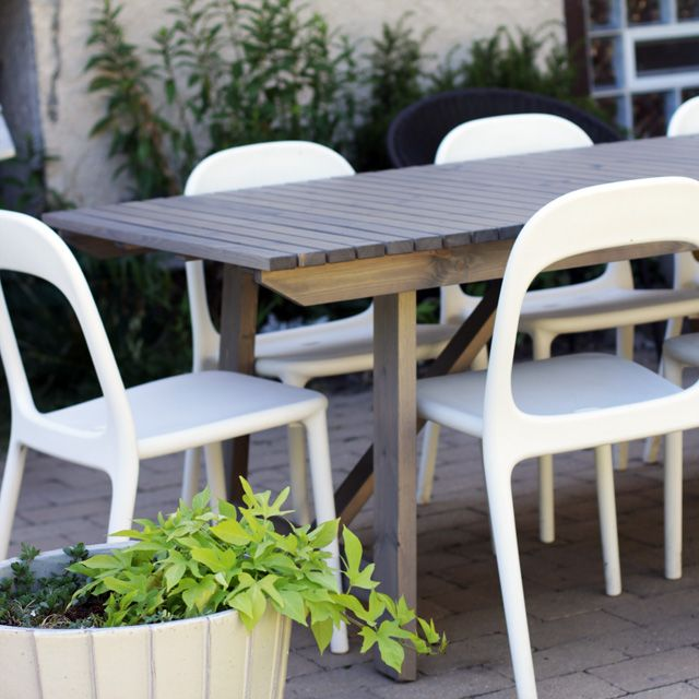 IKEA SUNDER  gray wood outdoor dining table  urban chairs in white. IKEA SUNDER  gray wood outdoor dining table  urban chairs in white