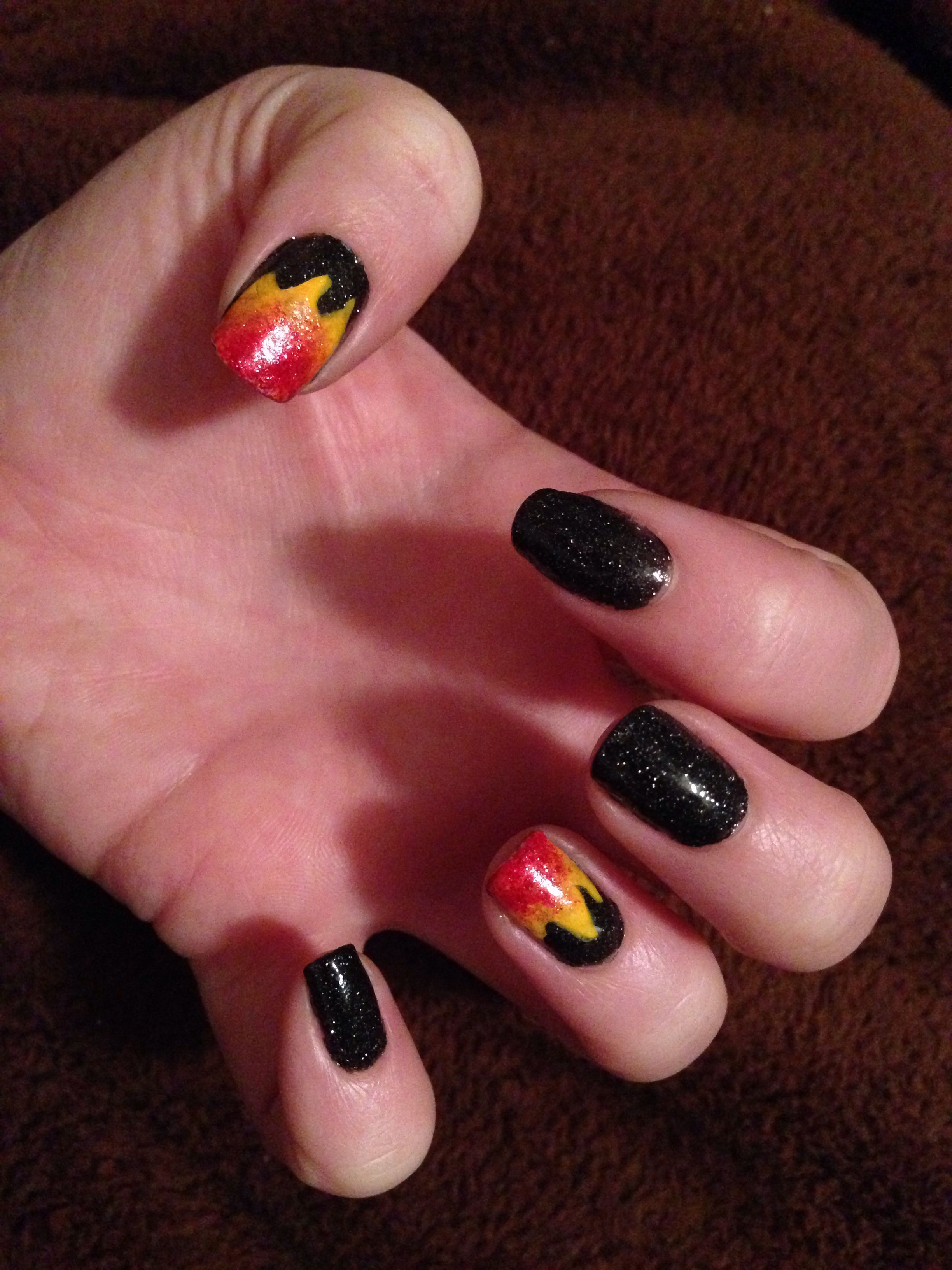 I wanted to do something cool on my nails since I was going to the Catching Fire premiere. I wasn't ambitious enough to attempt a Mockingjay, so I went with just flames for my Catching Fire nails... I think they turned out pretty well! :)