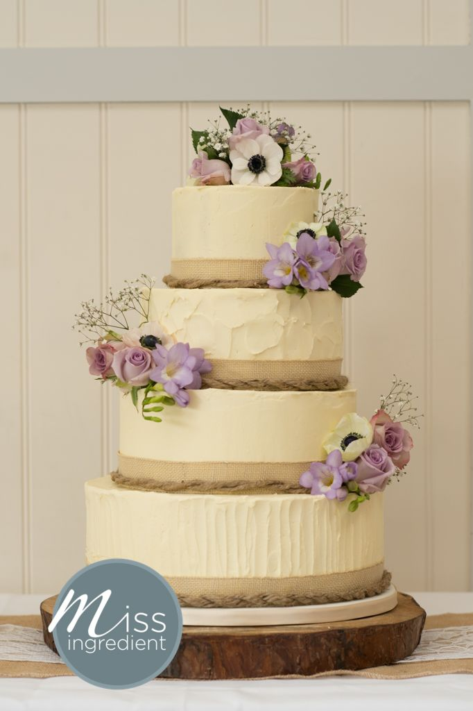 Rustic Style Buttercream iced Wedding Cake with fresh flowers from ...