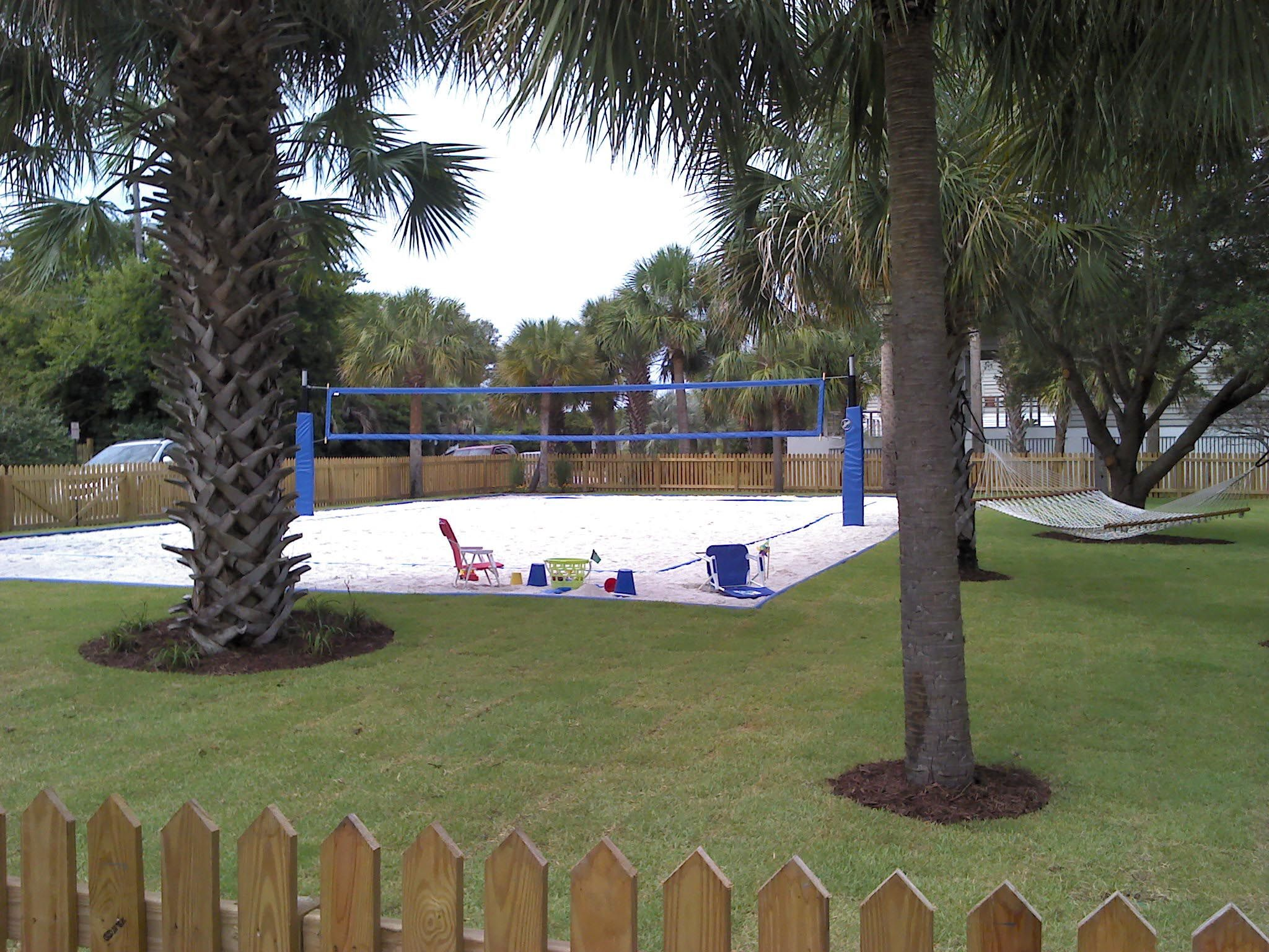 Backyard volleyball court sand volleyball court for Pool design for volleyball