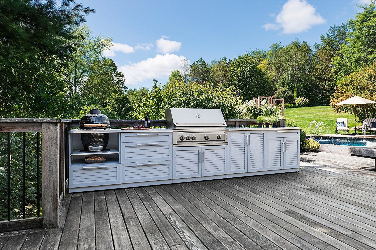 Outdoor Kitchen Is Ready For All Season Entertaining Louvered Doors Stainless Steel Handles And Powder Coated Paint Fin Outdoor Outdoor Kitchen Backyard Fun