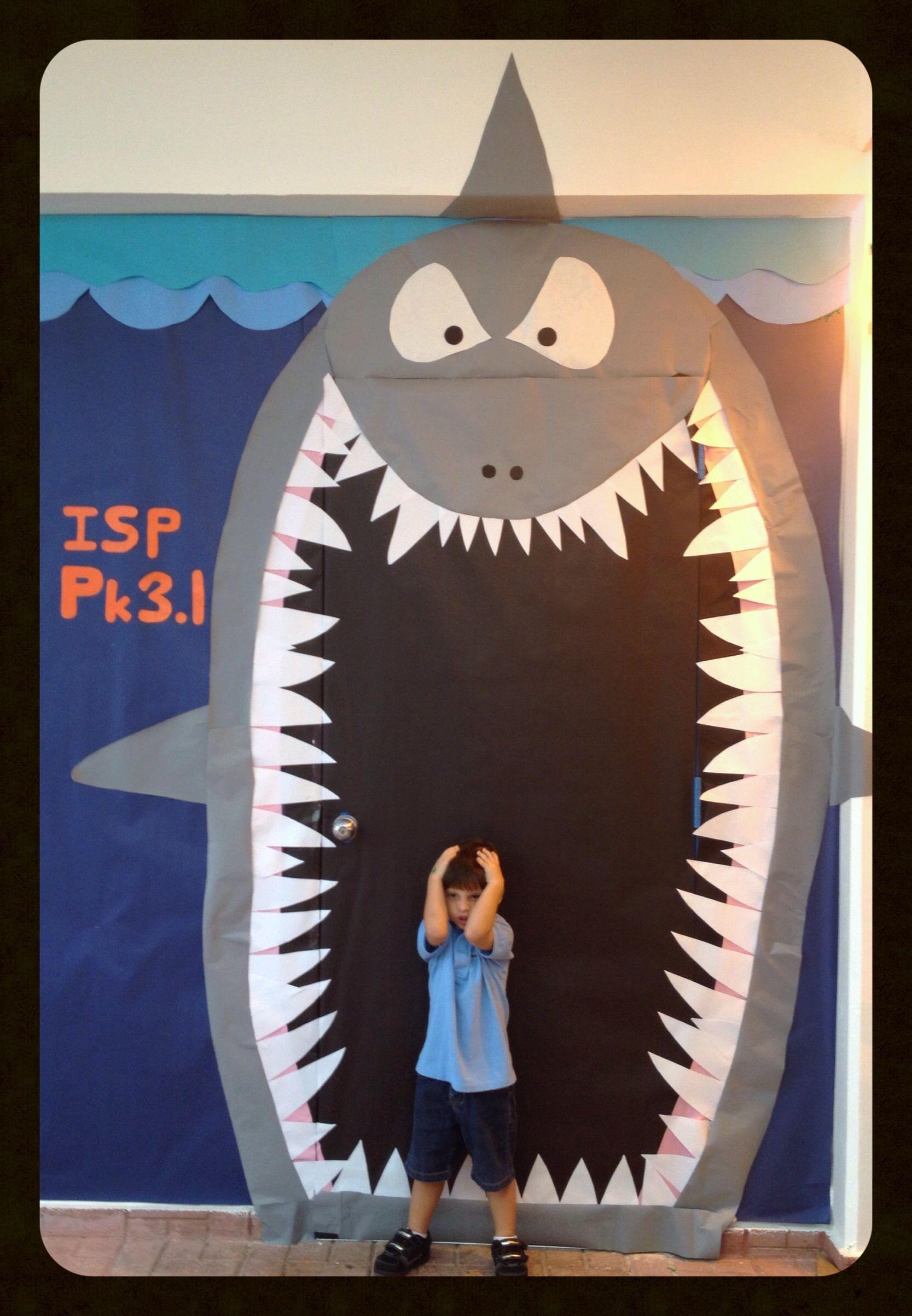 Classroom door decoration ocean shark i teach for Art decoration international