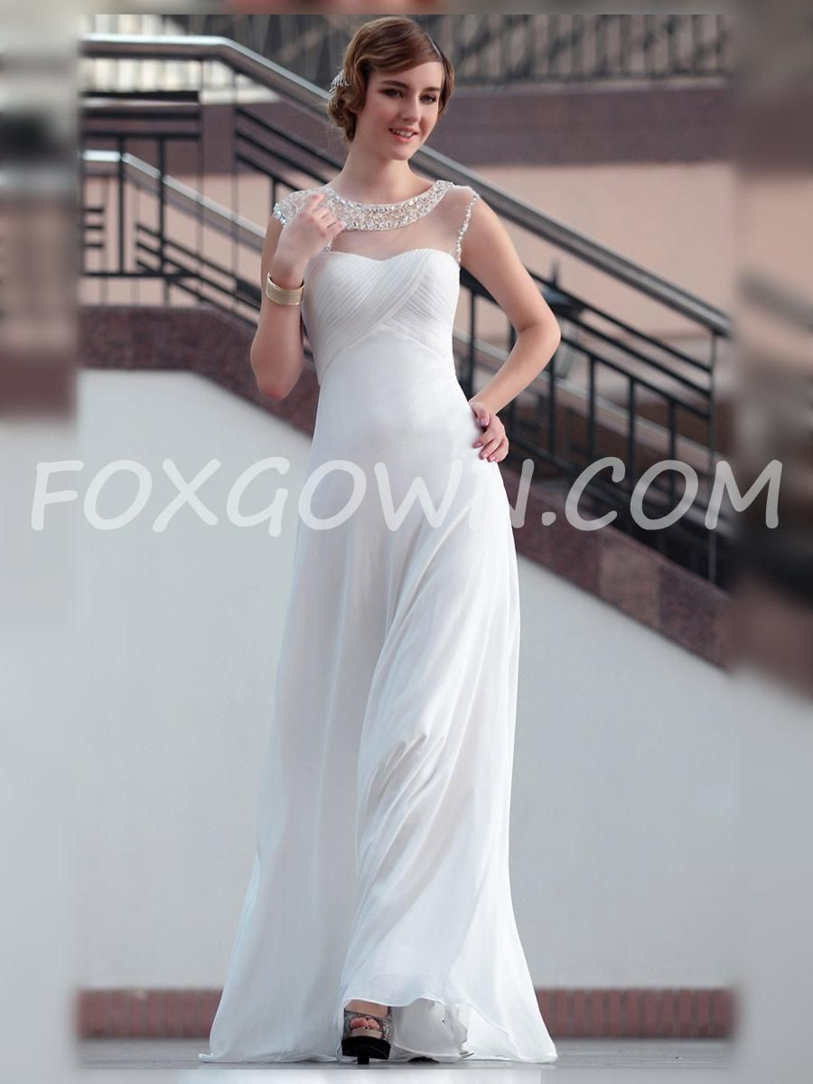Beautiful white sleeveless long formal dress with beaded sheer
