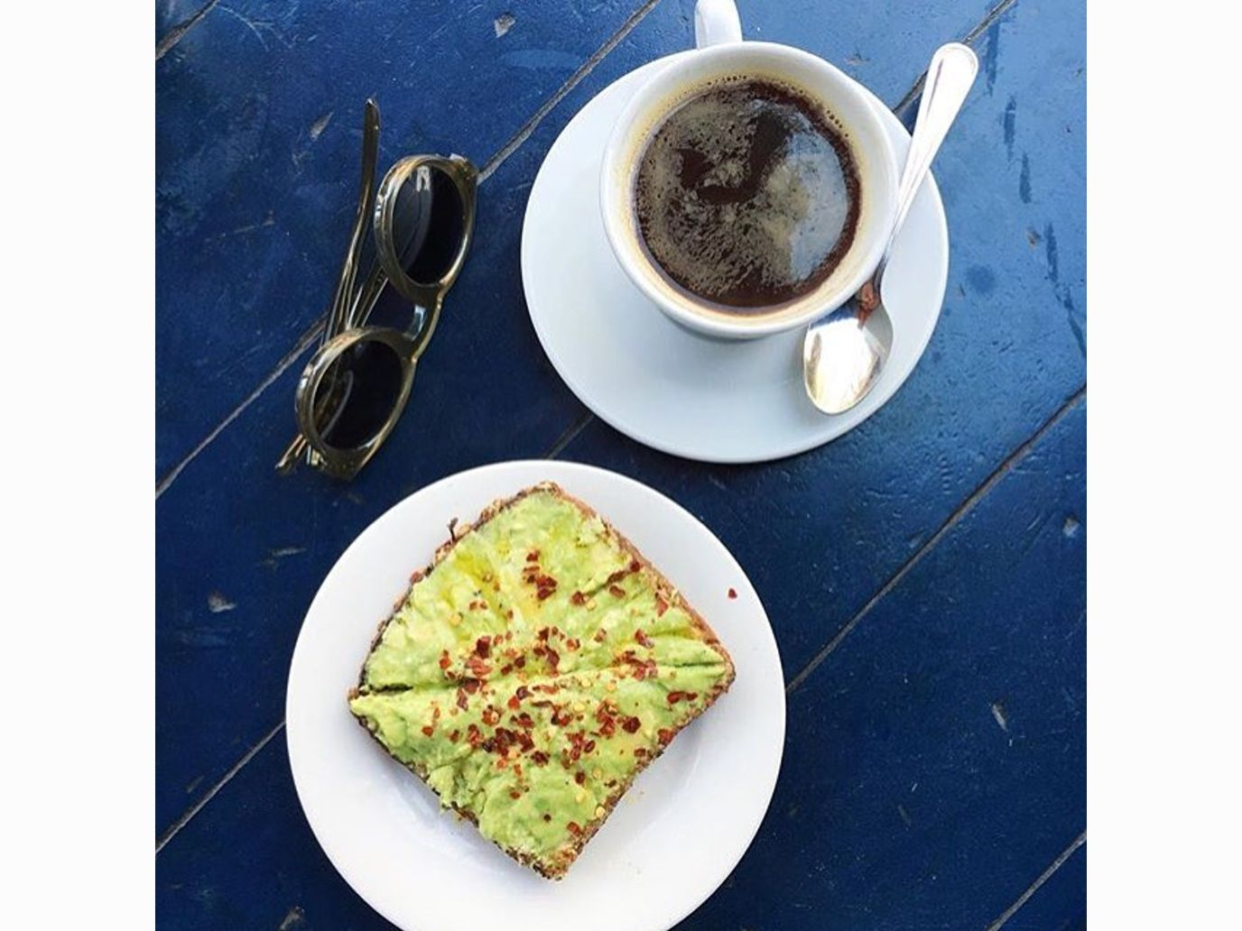 top a slice of seven-grain bread with avo mash, lemon juice, a drizzle of olive oil, and red pepper flakes.