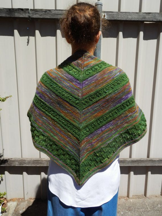 This triangle shawl has been made from two hand painted yarns, which I bought in a local yarn shop. I like to think the yarn didnt make a long