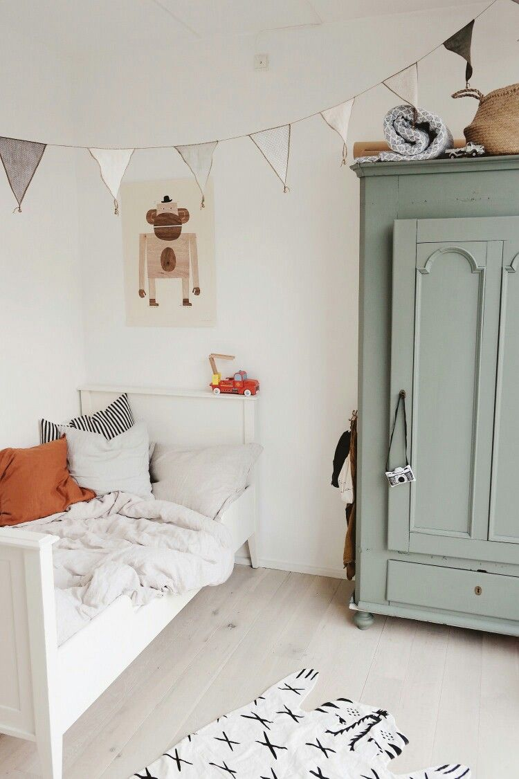 Modern Farmhouse Boyu0027s Room Design Featuring A Green Painted Armoire, A  White Wood Bed, Woven Illustrated Animal Rug, And Gray And White Banner  Garland ...
