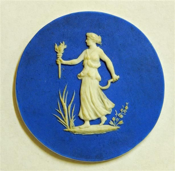 A Wedgwood jasperware plaque depicting Ceres, the Roman goddess of earth, agriculture and fertility, holding her symbolic attributes: a sickle and a flaming torch. (Kunsthistorisches Museum Vienna)