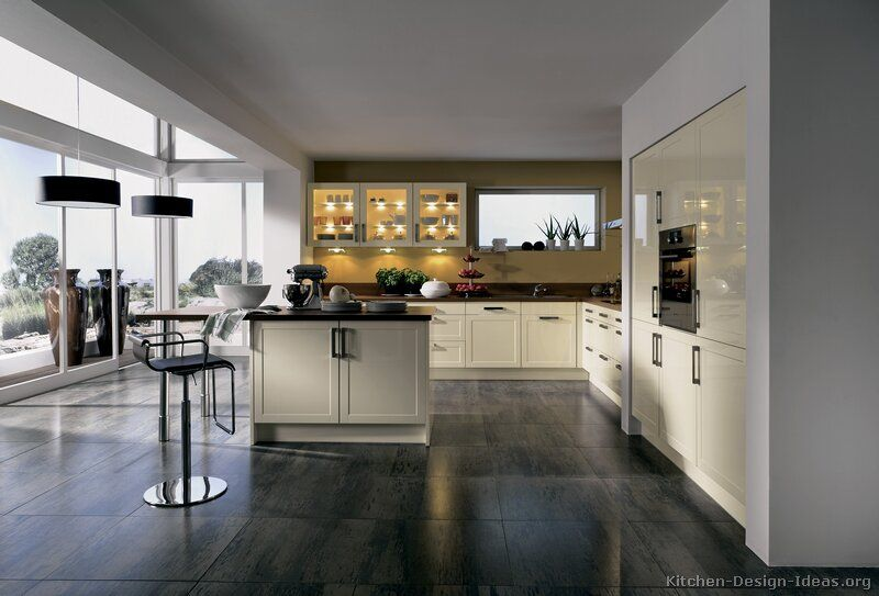 stunning white kitchen floors. A modern kitchen with cream cabinets  gray tile floors and a wide view of