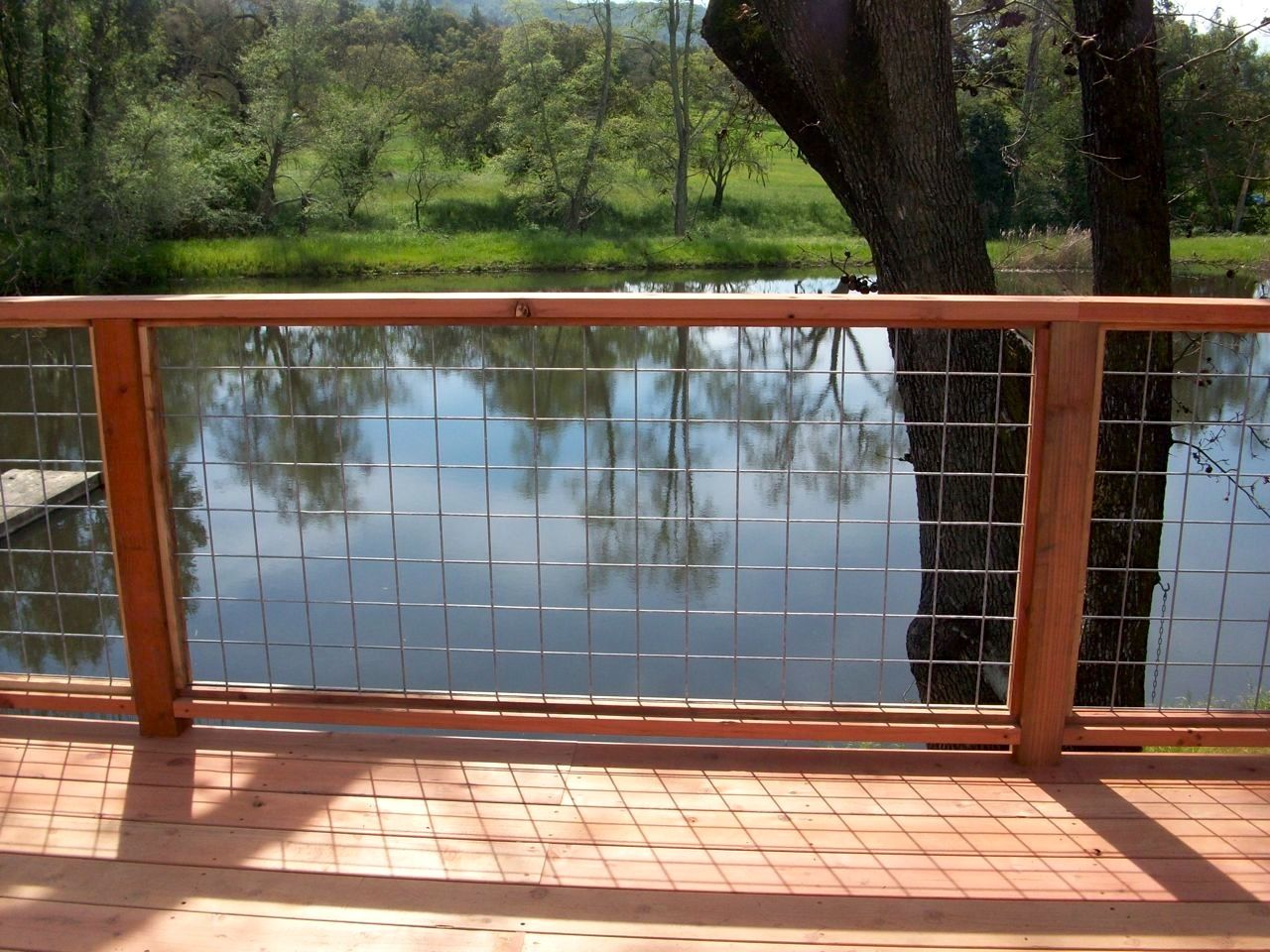 Redwood deck with 4x4 mesh handrail by arbor fence inc decks redwood deck with 4x4 mesh handrail by arbor fence inc baanklon Image collections