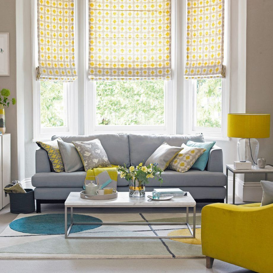 warm greybrown living room with yellow accents  ideal