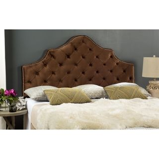 Enhance the look of your master suite with this sophisticated king-size headboard. Upholstered in chocolate velvet, this headboard features a regal silhouette trimmed with polished nailheads. This plu