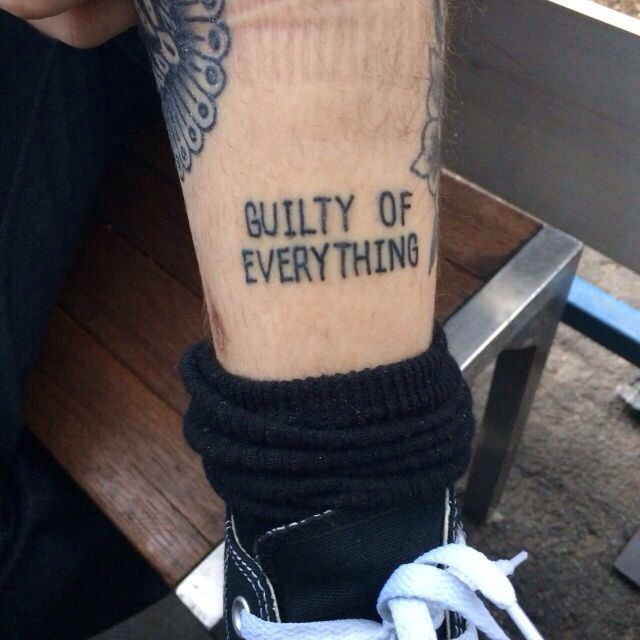 """""""Guilty of everything"""" ankle tattoo"""