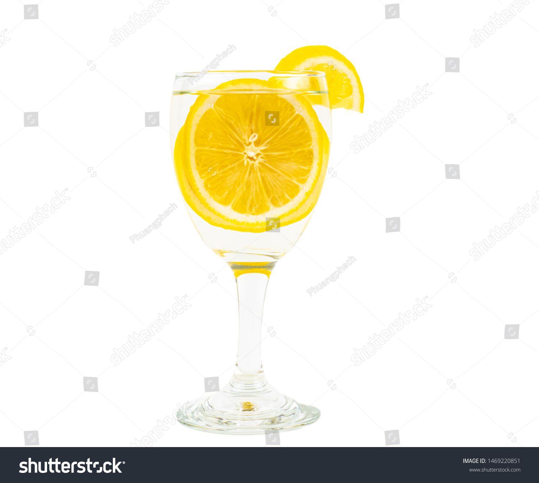 lemon in glass on white background