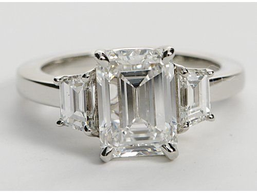 Kim Kardashian like step cut trapezoid setting with emerald cut diamond  from blue nile