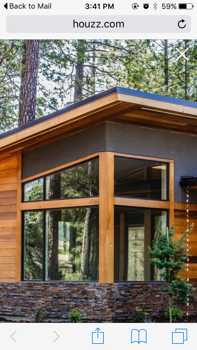 "Exterior: combination of rock, cedar, black aluminum, large, ""store front"" windows"