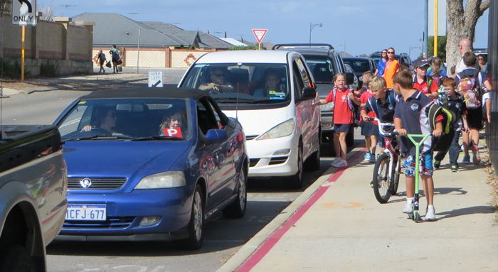 """We have parent volunteers who help the students to safely get into their cars at our """"kiss n drive."""""""