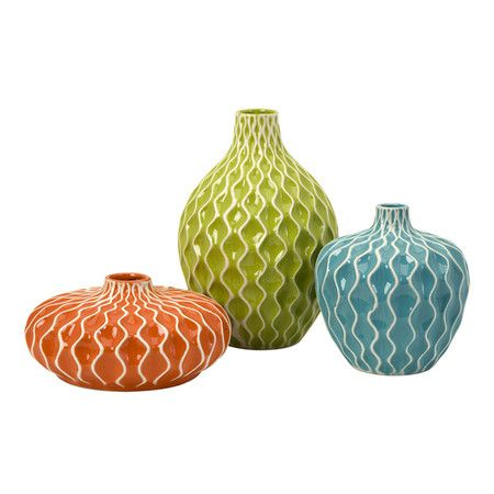 Set of three ceramic vases with raised wave motifs.Product: Small, medium and large vase  Construction Material: Ceram...