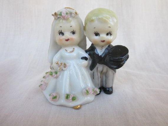 Lefton Wedding Cake Topper Vintage Bride and Groom Figurine Made in Japan. $15.99, via Etsy.  so cute!