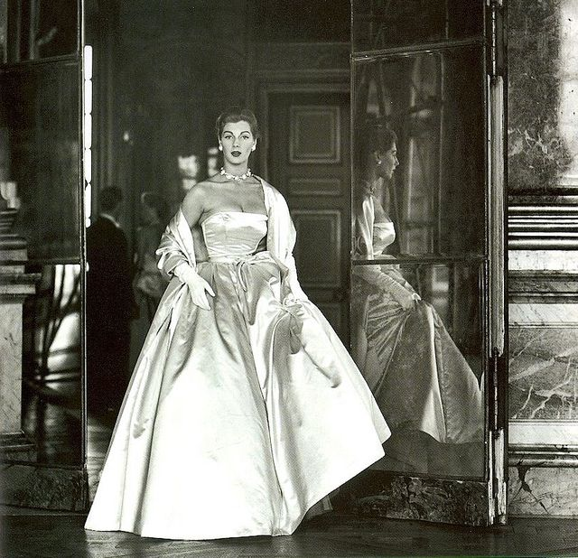 Fiona Campbell-Walter wearing a duchesse satin ball gown by Balenciaga, photo by by Frances McLaughlin-Gill at Versailles for Vogue 1952