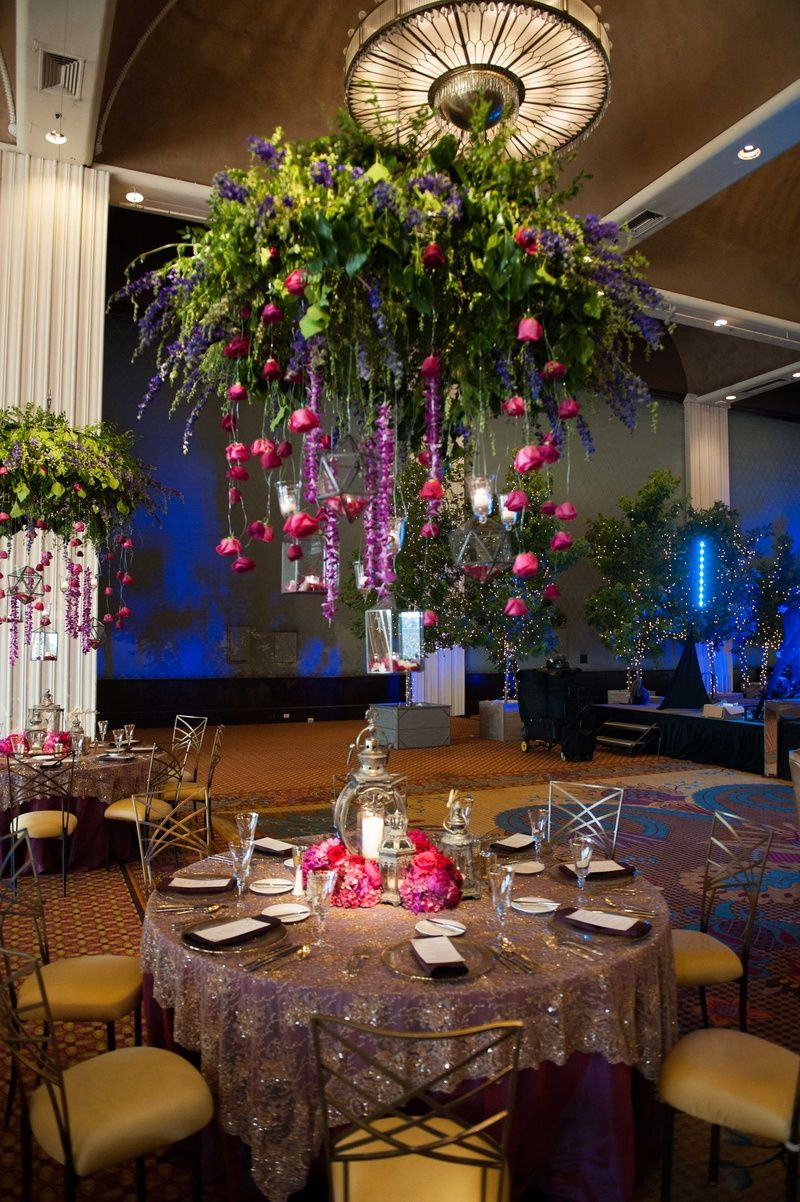 Catholic hindu ceremonies reception with enchanted forest theme reception dcor photos cascading floral arrangement over table junglespirit Images