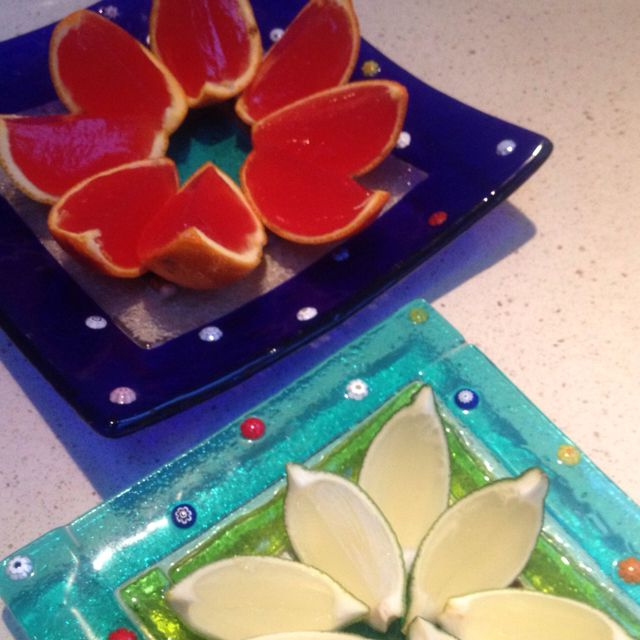 Marguerita lime jelly wedges and orange/raspberry jelly wedges. Just hollow out lime/orange halves, fill with jelly, refrigerate and cut into wedges.