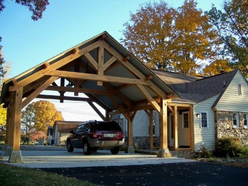 Airy porte cochere design homestead timber frames for Carport landscaping ideas