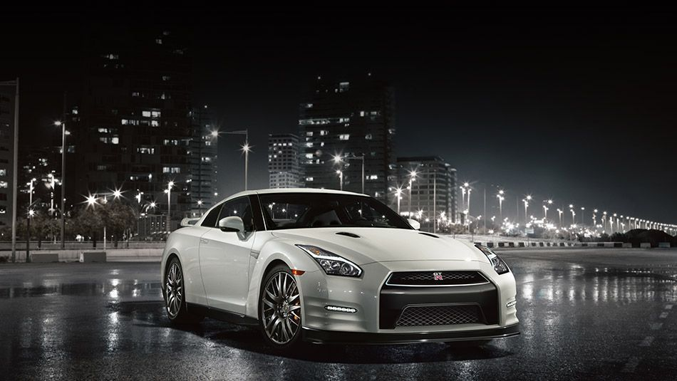 2016 Nissan GTR Sports Car Shown In Pearl White, Side View With Urban Night  Setting