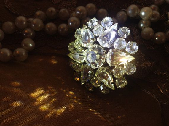 Round strass brooch of the 1950s vintage jewelry flower