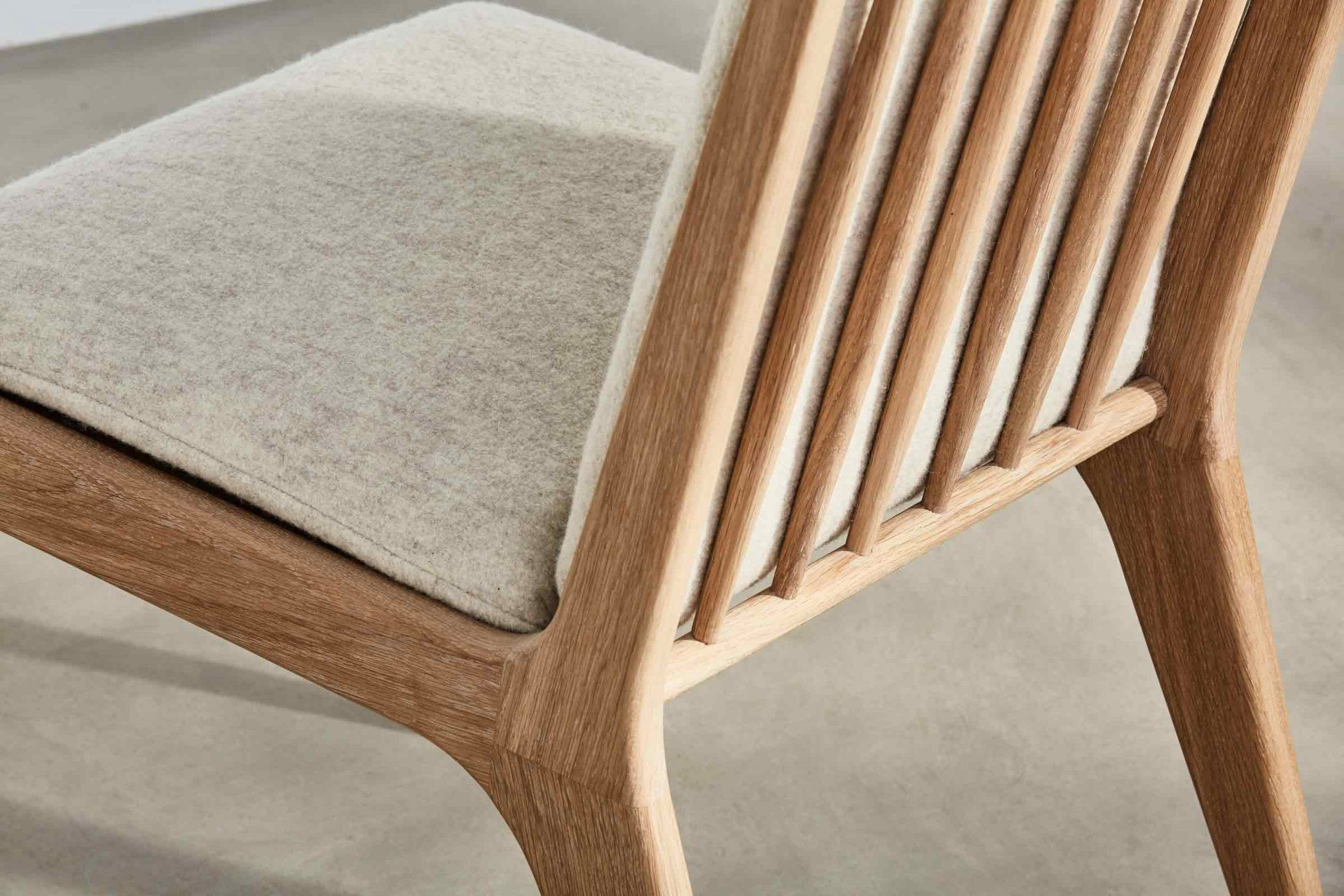 Spindle Backed Chair With White Wool Upholsterery