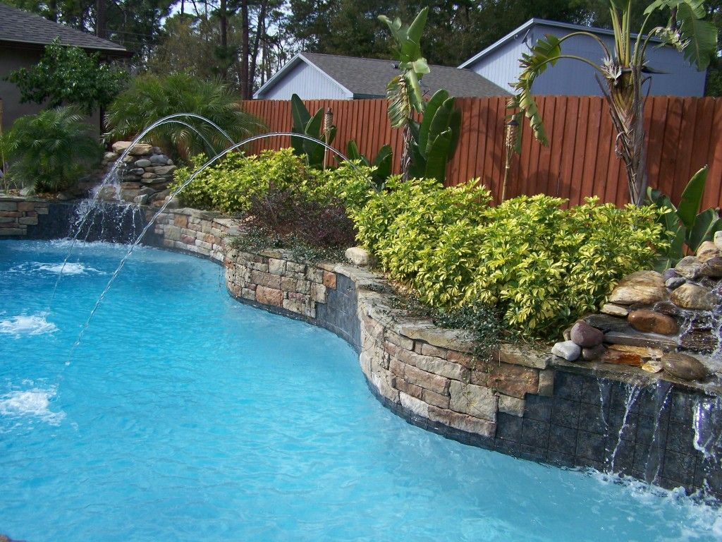 Swimming pool with waterfall and laminar jets water for Pool jets design